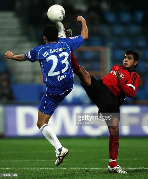 Shinji Ono of Bochum in action with Arturo Vidal of Leverkusen during the Bundesliga match between VfL Bochum and Bayer Leverkusen at the rewirpower...