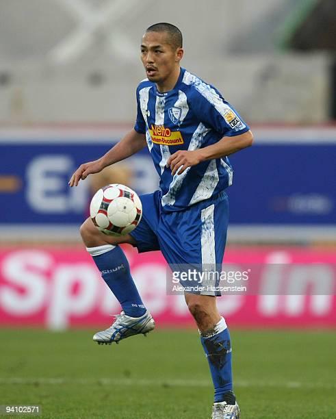 Shinji Ono of Bochum runs with the ball during the Bundesliga match between VfB Stuttgart and VfL Bochum at MercedesBenz Arena on December 5 2009 in...