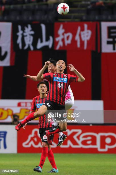 Shinji Ono of Consadole Sapporo and Yoshiki Takahashi of Sagan Tosu compete for the ball during the JLeague J1 match between Consadole Sapporo and...