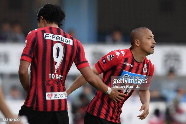 Shinji Ono of Consadole Sapporo is brought in for Ken Tokura during the JLeague J1 match between Jubilo Iwata and Consadole Sapporo at Yamaha Stadium...