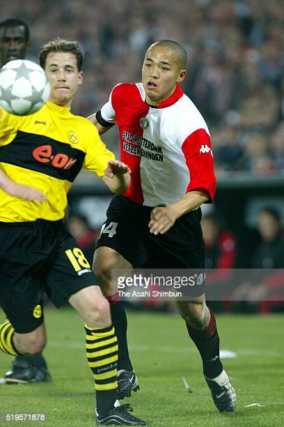 Shinji Ono of Feyenoord and Lars Ricken of Borussia Dortmund compete for the ball during the UEFA Cup final match between Feyenoord and Borussia...