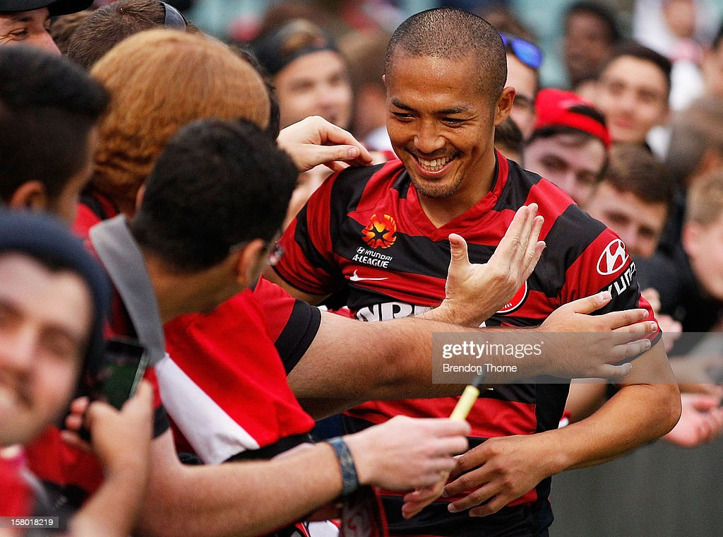 Shinji Ono of the Wanderers celebrates at full time with fans during the round ten A-League match between the Western Sydney Wanderers and the Brisbane Roar at Parramatta Stadium on December 9, 2012 in Sydney, Australia.