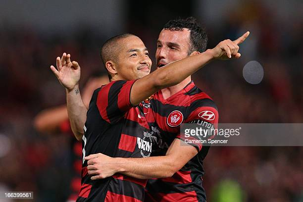 Shinji Ono of the Wanderers celebrates scoring a goal with team mate Mark Bridge during the ALeague Semi Final match between the Western Sydney...
