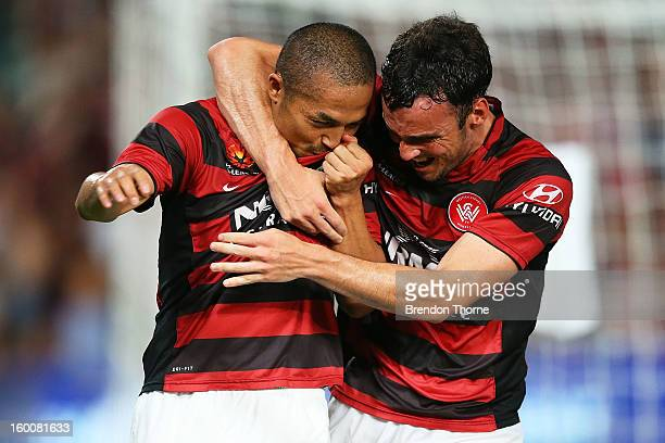 Shinji Ono of the Wanderers celebrates with team mate Mark Bridge after scoring a penalty during the round 18 ALeague match between the Western...