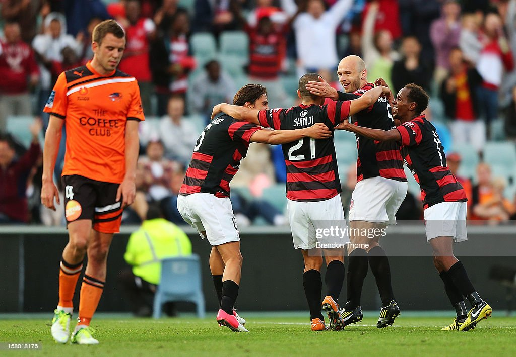 Shinji Ono of the Wanderers celebrates with team mates after scoring a penalty goal during the round ten A-League match between the Western Sydney Wanderers and the Brisbane Roar at Parramatta Stadium on December 9, 2012 in Sydney, Australia.
