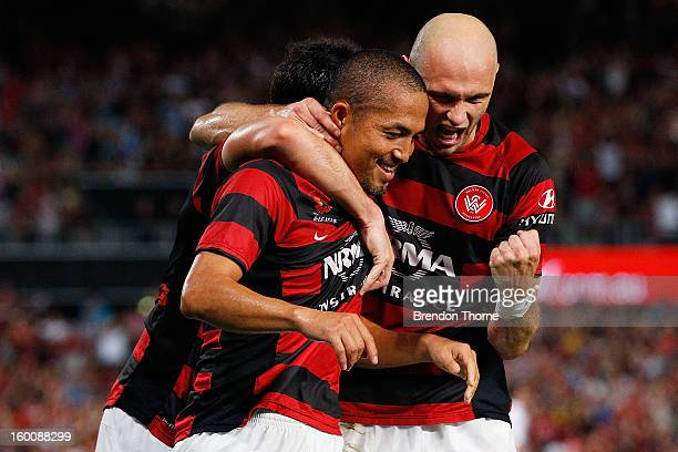 Shinji Ono of the Wanderers celebrates with team mates Dino Kresinger and Mark Bridge after scoring a penalty during the round 18 ALeague match...