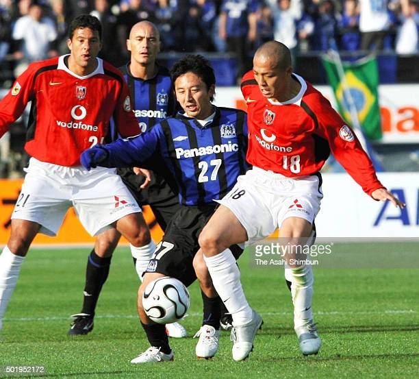 Shinji Ono of Urawa Red Diamonds and Hideo Hashimoto of Gamba Osaka compete for the ball during the JLeague match between Gamba Osaka and Urawa Red...