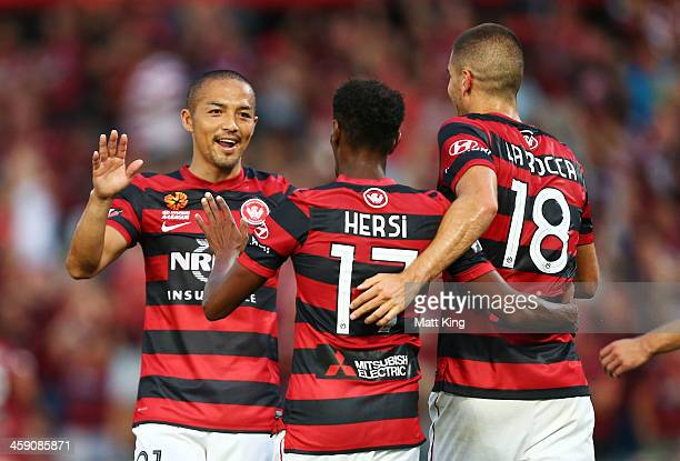 Shinji Ono Youssouf Hersi and Iacopo La Rocca of the Wanderers celebrate the first goal to Tomi Juric during the round 11 ALeague match between the...