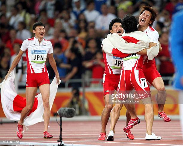 Shinji Takahira Shingo Suetsugu Nobuharu Asahara and Naoki Tsukahara of Japan celebrate winning a bronze medal in the Men's 4 x 100m Relay Final at...
