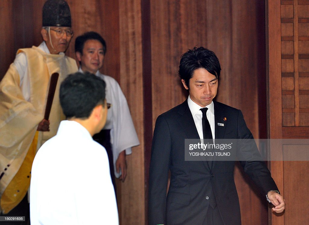 Shinjiro Koizumi (R), Japanese lawmaker and son of former Prime Minister Junichiro Koizumi, leaves the controversial Yasukuni shrine after honouring the dead on the 67th anniversary of Japan's surrender from World War II, in Tokyo on August 15, 2012. Jin Matsubara on August 15 visited the controversial Yasukuni Shrine in Tokyo, seen by neighbouring nations as a symbol of the country's militaristic past.