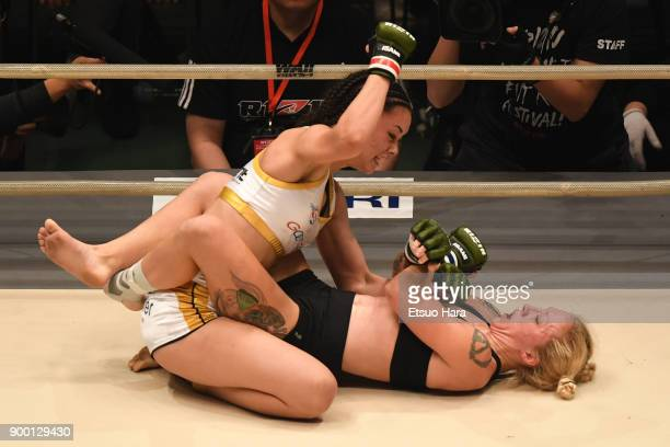 Shinju Nozawa Auclair of the United States and Chelsea LaGrasse of the United States compete in the women's bout during the RIZIN Fighting World...
