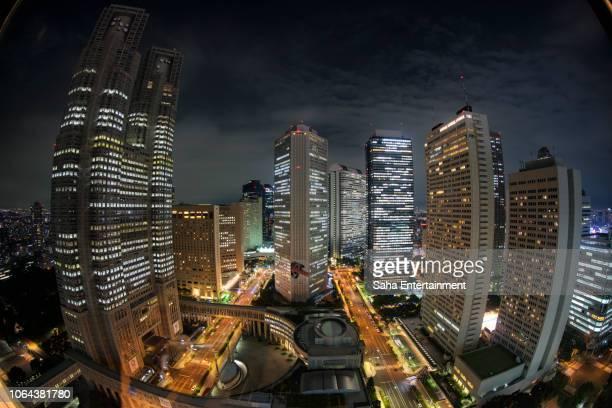 shinjuku buildings at night - saha entertainment stock pictures, royalty-free photos & images