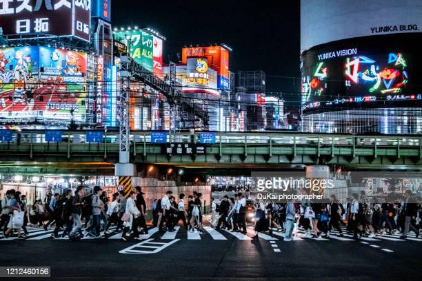 shinjuku  busy transportation rush hour at night - japan stock pictures, royalty-free photos & images