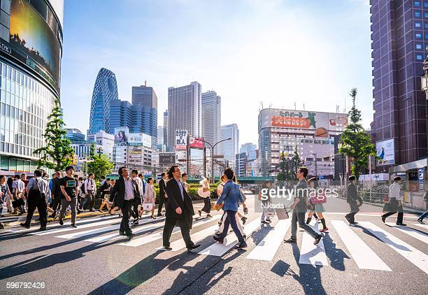 shinjuku shopping district, tokyo, japan - pedestrian crossing stock photos and pictures