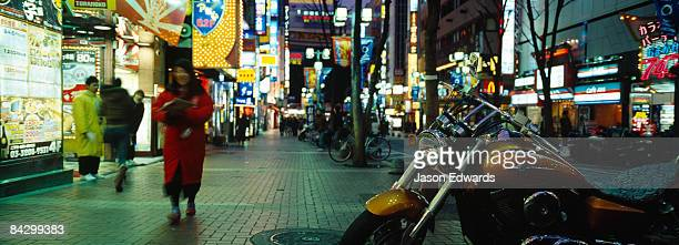 A motorbike parked in a restaurant district in downtown Shinjuku.