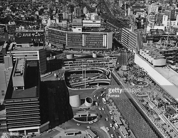 Shinjuku ward in Tokyo Japan showing the Odakyu department store and the entrance to an underground car park circa 1966