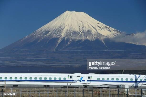 Shinkansen bullet train runs in front of snowcapped Mt Fuji between Mishima and ShinFuji Stations on February 17 in Fuji Shizuoka Japan