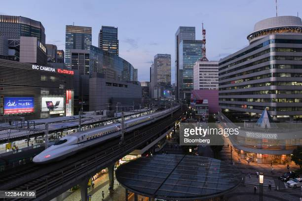 Shinkansen bullet train travels along an elevated railway track passing Yurakucho station in Tokyo, Japan, on Tuesday, Sept. 8, 2020. In Tokyo, the...