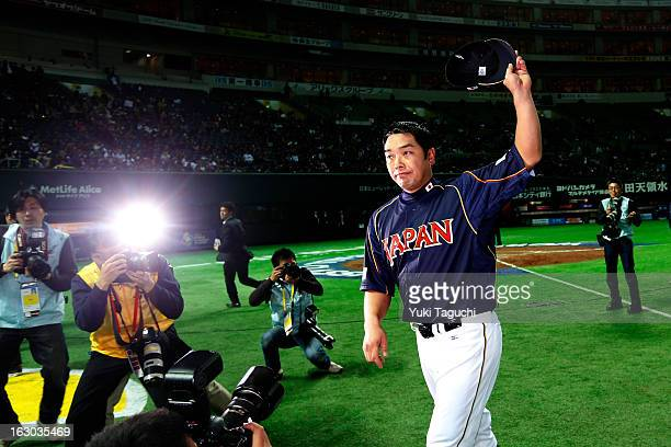 Shinnosuke Abe of Team Japan acknowledges the crowd after defeating Team Brazil in Pool A Game 1 in the first round of the 2013 World Baseball...