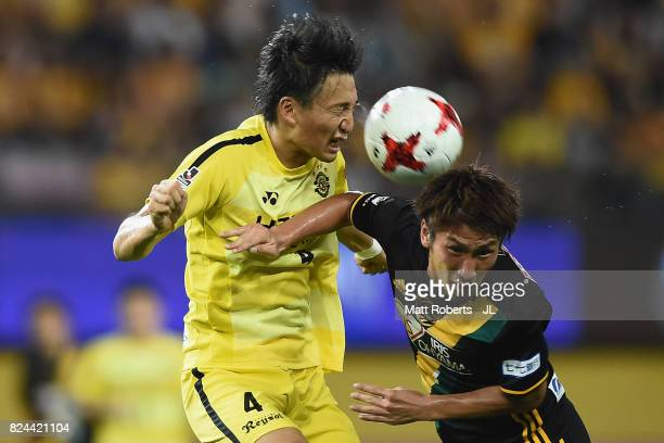 Shinnosuke Nakatani of Kashiwa Reysol and Hiroaki Okuno of Vegalta Sendai compete for the ball during the JLeague J1 match between Vegalta Sendai and...