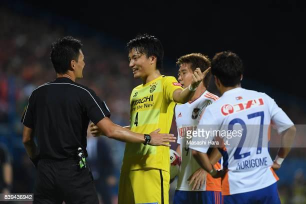 Shinnosuke Nakatani of Kashiwa Reysol protests to referee Ryuji Sato after shown a yellow card during the JLeague J1 match between Kashiwa Reysol and...