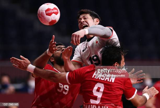 Shinnosuke Tokuda of Team Japan shoots at goal whilst being challenged by Husain Alsayyad and Hasan Alsamahiji of Team Bahrain during the Men's...