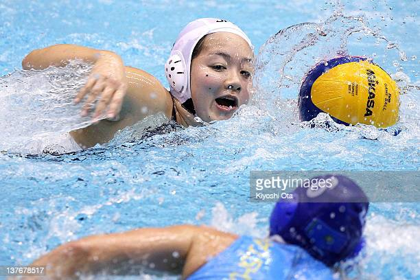 Shino Magariyama of Japan controls the ball against Anna Zubkova of Kazakhstan during the Asian Water Polo Championships 2012 match between Japan and...
