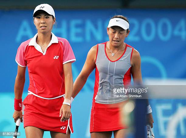 Shinobu Asagoe and Ai Sugiyama of Japan show their dejection after theri defeat in the Tennis Women's Doubles bronze medal match at the Olympic...