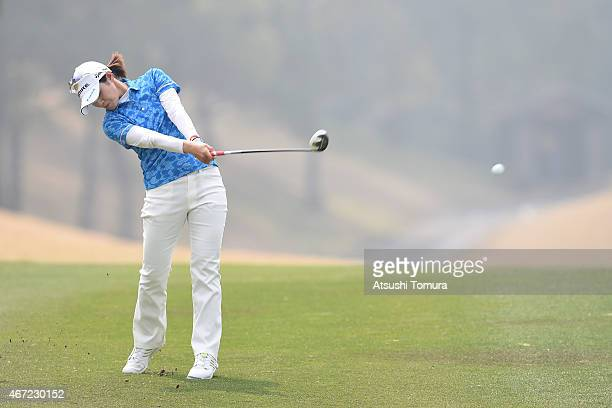 Shinobu Moromizato of Japan hits her second shot on the 11th hole during the final round of the TPoint Ladies Golf Tournament at the Wakagi Golf Club...