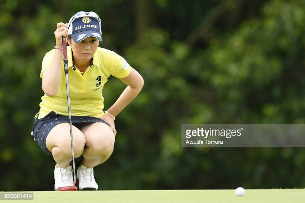 Shinobu Moromizato of Japan lines up her putt on the 5th hole during the first round of the Century 21 Ladies Golf Tournament 2017 at the Seta Golf...