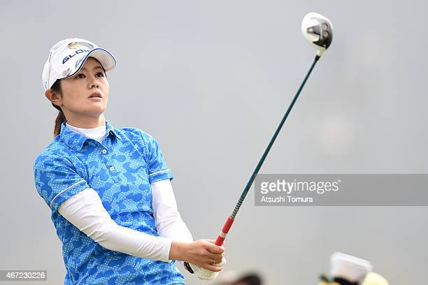 Shinobu Moromizato of Japan looks on to her tee shot on the 12th hole during the final round of the TPoint Ladies Golf Tournament at the Wakagi Golf...