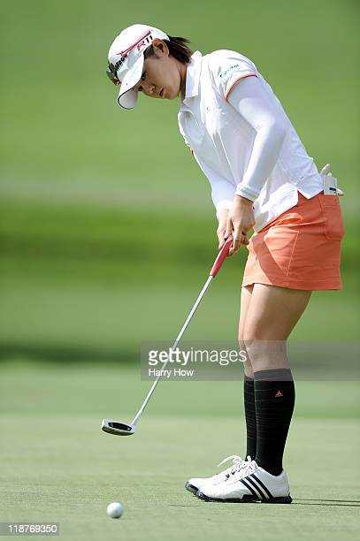 Shinobu Moromizato of Japan putts on the third green during the continuation of the third round of the 2011 US Women's Open at The Broadmoor on July...