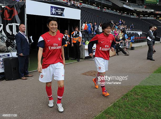Shinobu Ohno and Yukari Kinga of Arsenal walk out of the players tunnel before the match at Stadium mk on June 1 2014 in Milton Keynes England
