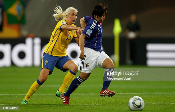 Shinobu Ohno of Japan and Josefine Oeqvist of Sweden battle for the ball during the FIFA Women's World Cup Semi Final match between Japan and Sweden...