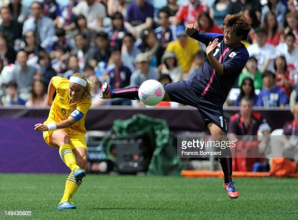 Shinobu Ohno of Japan and Sara Thunebro of Sweden battle for the ball during the Women's Football first round Group F Match between Japan and Sweden...