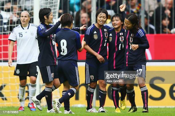 Shinobu Ohno of Japan celebrates her team's first goal with team mates during the Women's International Friendly match between Germany and Japan at...
