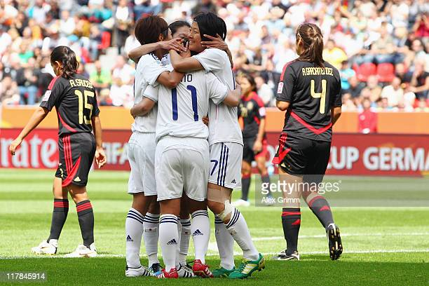 Shinobu Ohno of Japan celebrates her team's second goal with team mates during the FIFA Women's World Cup 2011 Group B match between Japan and Mexico...