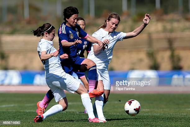 Shinobu Ohno of Japan challenges Elise Bussaglia and Laura Boulleau of France during the Women's Algarve Cup match between Japan and France on March...
