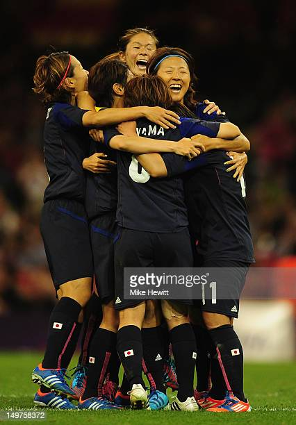 Shinobu Ohno of Japan is mobbed by team mates after scoring her team's second goal during the Women's Football Quarter Final match between Brazil and...