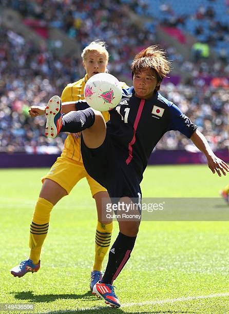 Shinobu Ohno of Japan passes the ball during the Women's Football first round Group F Match of the London 2012 Olympic Games between Japan and Sweden...