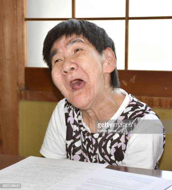 Shinobu Sakamoto a Minamata disease patient who suffered mercury poisoning while in the womb speaks to reporters in the southwestern Japan city of...