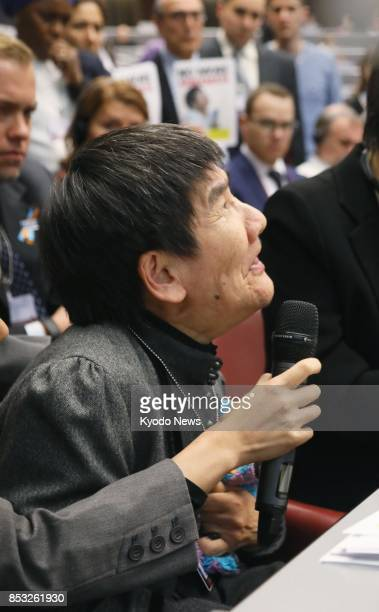 Shinobu Sakamoto a Minamata mercurypoisoning disease patient makes a statement during the first conference of signatory states of an international...