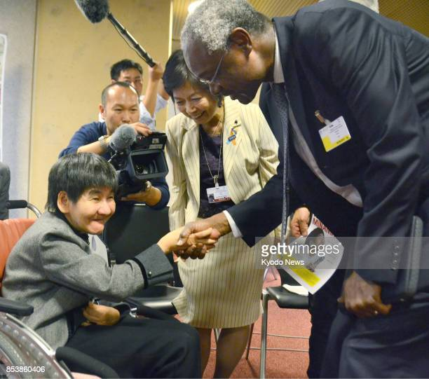 Shinobu Sakamoto a Minamata mercurypoisoning disease patient meets with UN Environment Programme Deputy Executive Director Ibrahim Thiaw in Geneva on...