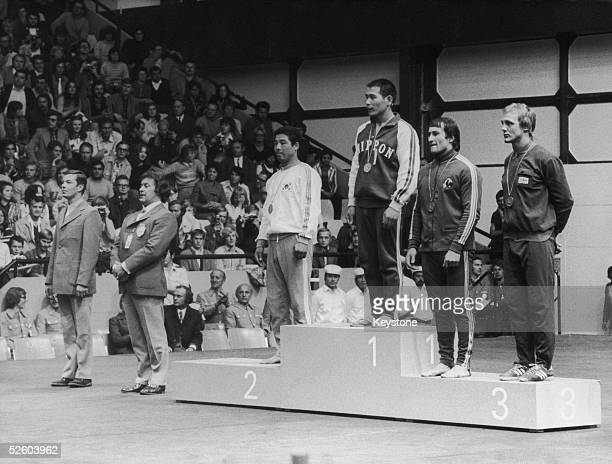 Shinobu Sekine of Japan wins the gold medal in the middleweight judo event at the Munich Olympics 4th September 1972 Oh Seunglip of South Korea wins...