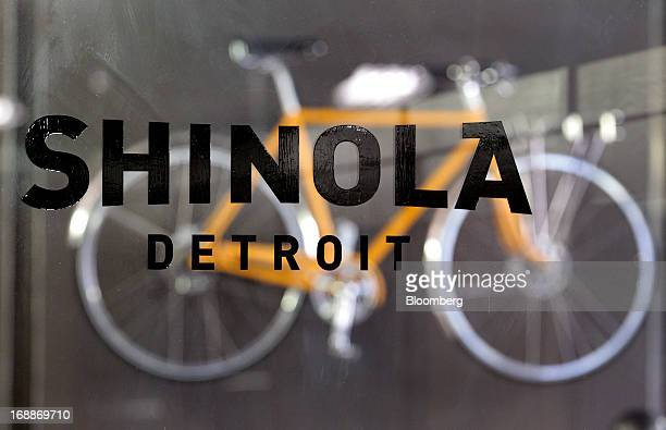 Shinola signage is seen in front of bike on display at the the company's production facility in Detroit Michigan US on Wednesday May 15 2013 Shinola...
