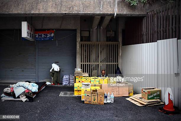 Shinpei Kirita who has lived homeless in Kamagasaki for ten years rests behind the boxes he has piled up around his bed in the slum area of...