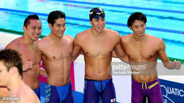 Shinri Shioura Yuki Kobori Yasuhiro Koseki and Ryosuke Irie of Japan pose for photographs after competing in the Men's 4x100m Medley Relay final on...