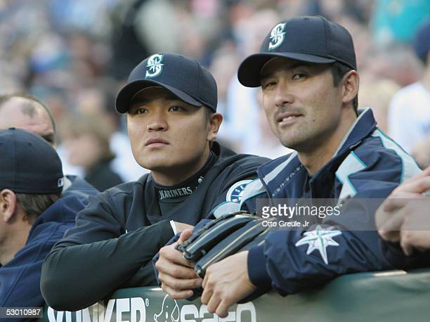 ShinSoo Choo and Shigetoshi Hasegawa of the Seattle Mariners look on from the dugout prior to the awarding of the MLB Historic Achievement Award by...