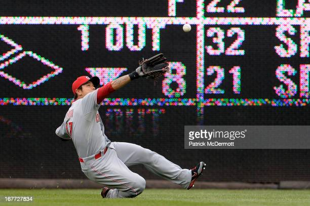 ShinSoo Choo of the Cincinnati Reds fails to catch an Ian Desmond of the Washington Nationals RBI double in the eighth inning during a game at...