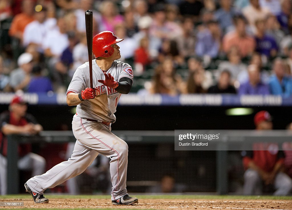 Shin-Soo Choo #17 of the Cincinnati Reds hits an eighth inning RBI double against the Colorado Rockies during a game at Coors Field on August 31, 2013 in Denver, Colorado. The Reds beat the Rockies 8-3.